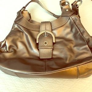Coach authentic bronze all leather shoulder bag.